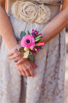 pink corsage for the mother of the bride or bridesmaids #corsage #weddingflorals #weddingchicks http://www.weddingchicks.com/2014/03/25/hot-pink-and-purple-two-day-wedding/