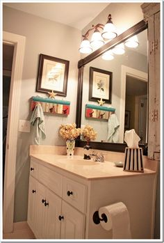 Wedgewood Gray by Benjamin Moore.  I like the mirror, lights and paint