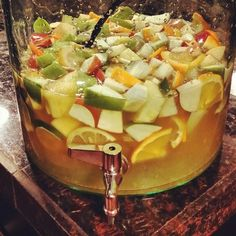 White Sangría  Ingredients:  3 bottles dry white wine, Moscato, Pinot Grigio or Sauvignon Blanc.  1 can (12 ounces) lemon-lime frozen juice.  1 cup brandy or Calvados (apple liqueur).  3 medium green apples, sliced (or 3 cup frozen unsweetened strawberries).  3 cups fresh pineapple cubed or frozen unsweetened sliced peaches 1 medium each, lemon, orange and lime, sliced.  1 Pint of raspberries.  1  2 lt. bottle lemon-lime soda, chilled or served over individual glasses with ice.