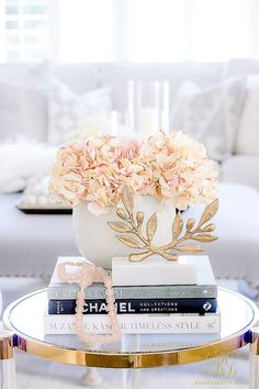 Spring Home Tour. The sweet accessories on my family room coffee table. Blush beads, white hydrangeas, fashion books, and a gold laurel leaf make a pretty statement. Coffee Table Styling, Coffee Table Books, Decorating Coffee Tables, Top Fashion, Fashion Books, Home Decor Accessories, Decorative Accessories, Coffee Table Accessories, Books Decor