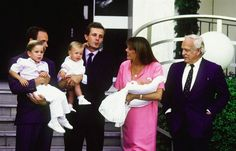 Prince Rainier III of Monaco watches as Princess Caroline holds her baby, Pierre Casiraghi. Prince Albert (far left) holds her other son, Andrea, and husband Stefano Casiraghi holds daughter Charlotte at the Princess Grace Hospital in 1987 in Monte Carlo, Monaco.