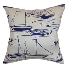 """Bring a pop of nautical charm to your sofa or favorite reading nook with this cotton pillow, featuring a moored sailboats motif and down fill. Made in the USA.   Product: PillowConstruction Material: Cotton cover and 95/5 down fillColor: Navy and whiteFeatures:  Insert includedHidden zipper closureMade in the USA Dimensions: 18"""" x 18""""Cleaning and Care: Spot clean"""
