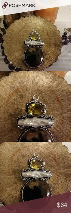 Rare Vintage 925 Mexican Artisan Silver Pendant All of these pieces are coming from a family estate, this one purchased in the 1980s also in New Mexico. Main Stone same size as a silver dollar, and is a rich chocolatey agate. Above is a super rare sized Baroque pearl, never seen one that long but nature makes beautiful mistakes! Looking them up online that size is pretty rare, seeing the back of it through the silver pretty cool. Topped by rich dimesized faceted citrine! Classic borders with…
