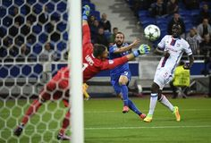 Juventus' Argentinan forward Gonzalo Higuain (C) shoots the ball next to Lyon's French defender Mouctar Diakhaby (R) and in front of Lyon's Portuguese goalkeeper Anthony Lopes (L) during the Champions League football match between Olympique Lyonnais and Juventus on October 18, 2016  at the Parc Olympique Lyonnais stadium in Decines-Charpieu near Lyon, southeastern France.    / AFP / PHILIPPE DESMAZES