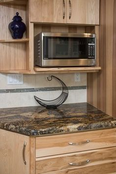 Custom hickory cabinetry with microwave storage to allow more counter space. www.remodelworks.com