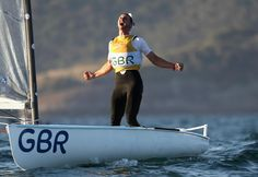 Giles Scott of Great Britain celebrates clinching a gold medal after his second finn class race