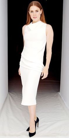 Amy Adams took in the Calvin Klein Collection show in the label's white sheath and black pumps.