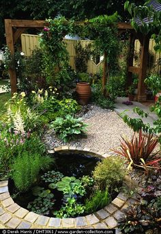 Backyard casual patio. Why not add a pond?  And the hardscape used is rather inexpensive!