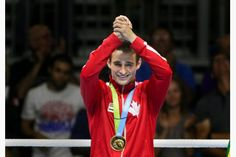 Canadian Arthur Biyarslanov celebrates his win over Yasnier Toledo of Cuba in a split decision in boxing for gold. RICHARD LAUTENS / TORONTO STAR