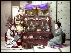 """HINA MATSURI -- """"GIRLS DAY""""   Although I do have others, this is one of the best Meiji-era close-content images of the Japanese Doll Festival decorations I have seen during my old-photo-collecting days.  """"The Japanese Doll Festival, or Girls' Day, is held on March 3, the third day of the third month. Platforms with a red hi-mōsen are used to display a set of ornamental dolls (hina-ningyō) representing the Emperor, Empress, attendants, and musicians in traditional court dress of the Heian…"""