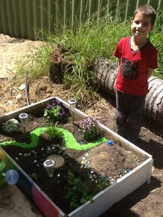 Just make a raised bed or a low planter yourself for a fairy/dino garden
