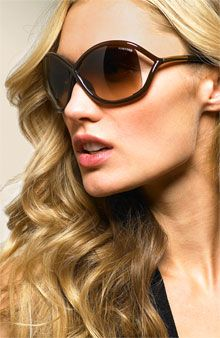 I want Tom Ford sunglasses. These are awesome. Her hair is great too of Course
