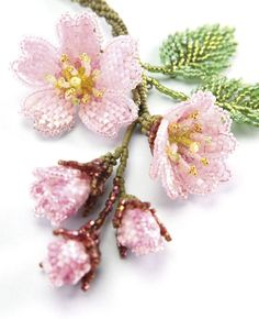 Sakura - Cherry Blossoms created by seed beads in Jan. Love these kind of beads. They remind me of a knitted sweater. They are cylinder beads. Beaded Flowers Patterns, Seed Bead Patterns, Jewelry Patterns, Beading Patterns, Seed Bead Jewelry, Bead Jewellery, Beaded Jewelry, Seed Beads, Seed Bead Flowers