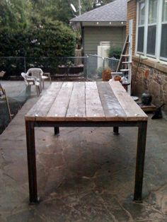 Gardening table made from angle iron, and wood from an old trailer. Repurposed. Carriage bolts add a touch of class!