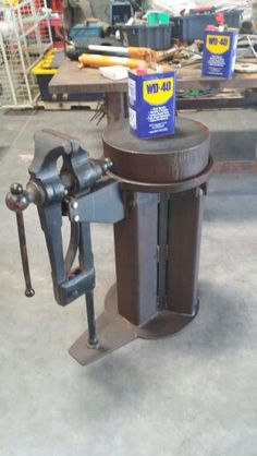 Large post vise on custom disc anvil heavy duty base...and someone enjoys the WD-40 too.