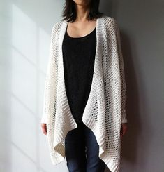 Juxtaposing relaxed silhouette with slender sleeves, this trendy cardigan perfectly captures effortless sophistication. The oversized cardigan, with its sleeves beginning at elbow, drapes beautifully into a high-low hemline and is flattering for all body shapes. With ribbed cuffs and borders, and worked seamlessly in a simple mesh stitch pattern, this cardigan is perfect for the beginners, as well as for the experienced to crochet while watching TV.Angelina, a knitted version of Angela is…