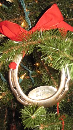 "This Sycamore Hill design hangs on my tree with a decorative ribbon (enclosed). The Happy Holidays stamped piece is a magnet. It can be changed out for different holidays or events. I've also ordered this horseshoe and used it as decoration around a bottle of liquor as a ""good luck"" gift (for an adult!!)."