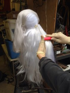 5.  For these looks I hot glued styrofoam pieces onto the base mesh of wig before structuring the hair.