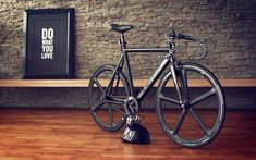 "Black fixie bike, cool wall and ""Do what you love"" poster."