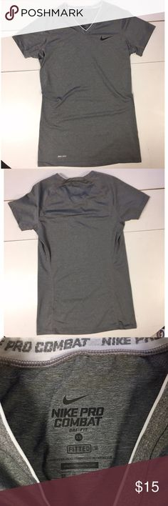Nike Pro Combat Fitted Compression Shirt Dri Fit Excellent condition! Like new. No stains, holes or tears. Nike Pro Combat Dri Fit Fitted Compression T-Shirt. Size XS. Gray. 84% Polyester 16% Spandex. Great for workouts or everyday wear. Nike Tops Tees - Short Sleeve