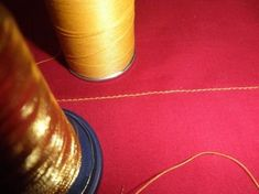 To sew with delicate decorative thread so it won't break, use two spools of thread - the fancy one and a regular one of similar color. Thread them through the machine the same way you would a single thread. Now when you sew with the delicate decorative thread, the regular thread will help support it.