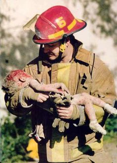 This photograph gave to Charles Porter the 1996 Pulitzer Prize for Spot News Photography. The photograph shows a firefighter carrying a baby away from the disaster