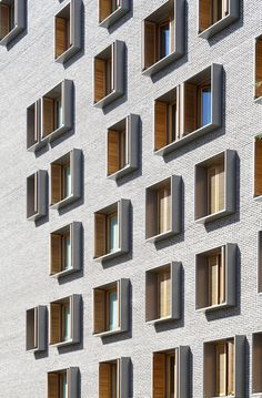 dezeen:  Michel Guthmann pairs grey brick with larch for Paris housing block