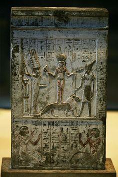 Qetesh wearing the headdress of Hathor and standing on a lion. She holds a lotus flower to Min and a snake to Resheph. Stele de Qetesh réprésentant des égyptiens et des étrangers ainsi que les dieux Qetesh (Syrie), Min (Egypte) et Resheph (Egypte) Stèle exposé au Musée du Louvre à Paris.