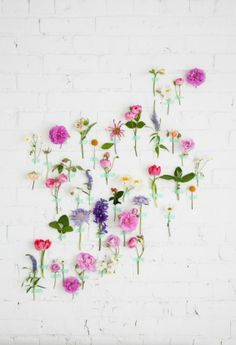 decorating with flowers - stick em on the wall with #washi #tape for greater effect.