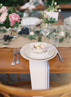 At this intimate Napa wedding, simplicity is the key: Blueberries and leaves are arranged around small vases, making for a perfectly intimate dinner.  MORE WEDDINGS on elledecor.com: 10 Buy-It-Yourself Wedding Items for the Unapologetically Single   - HarpersBAZAAR.com