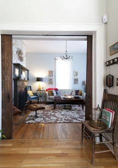 Mix of wood floors and white trim, old wood and eclectic mix