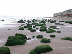 Stones next to cliffs on Hunstanton Beach Norfolk England