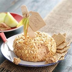 Caramel Apple Cheese Ball (1 can Pillsbury Creamy Supreme Caramel Apple Flavored Frosting 1 (8 oz.) package cream cheese 1 cup chopped cocktail peanuts)