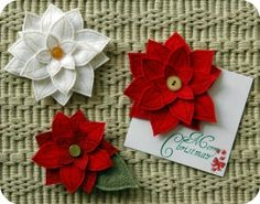 Felt Poinsettia Pin Pattern by Embroidery Garden: Maybe hot glue these to magnets to hang Christmas cards on the frig...