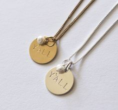 Handstamped 5/8″ disc with pearl dangle. Sterling or brass option available.
