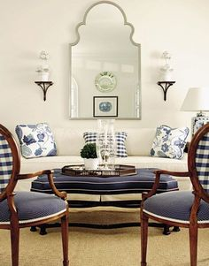 Navy BlueCoastal living rooms Paint colors and Ottomans