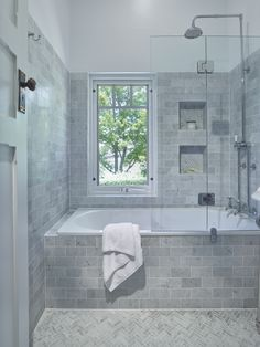 Traditional Bathroom - lovely inset bath with a shower combo, handy niche to keep all your bath/ shower items close . Nice subway tiles
