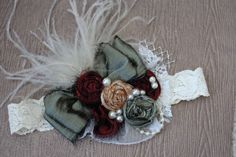 Fall colors headband. Made with dupioni silk rosettes, embellished with lace, pearls, feathers and netting. This piece is so cute and will match many fall outfits. Definite head turner.  Please specify on sizing.