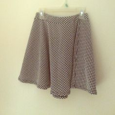 M Wet Seal High Waisted Skirt Medium high waisted black and white polka dotted skirt. Brand is Wet Seal. Worn twice. Polyester fabric. Wet Seal Skirts Circle & Skater
