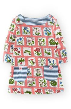 Mini Boden Print Tunic (Toddler Girls, Little Girls & Big Girls) at Nordstrom.com. A gorgeous floral print swirls across a delightful jersey tunic detailed with a pair of jaunty, striped contrast pockets.