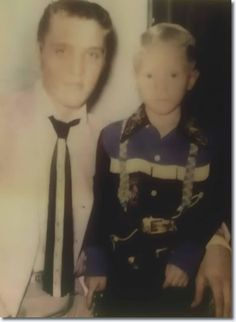 Elvis back stage with child, Jerry Turner, who would grow up to be a policeman assigned to guard Elvis' body at his funeral. Jerry describes his duty at Elvis' funeral as the saddest of his life ...