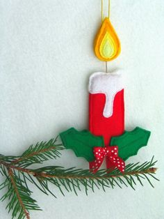 Decorations for christmas tree. Felt candle. For sale.
