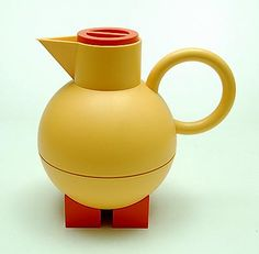 Yellow plastic thermos-jug Euclid on orange stands and with orange cover design Michael Graves 1994 executed by Alessi / Italy