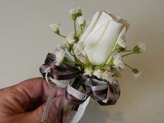 How to make a Boutonniere:  Rose, baby's breath, floral tape, ribbon, floral wire, & corsage pin