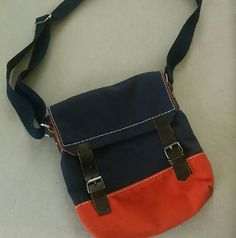 Tokyobay blue/orange crossbody canvas bag- NWOT Brand new, never used, no tags.                  Please see all pictures.   PLEASE, REASONABLE OFFERS ONLY!  -Smoke and pet free - If its $10 or under, I WILL NOT accept offers. -I do not model anything; everything looks different on everyone and I don't wasn't too Jade that. I will put the item on a dress form or find factory pics and provide measurements. -NO HOLDS, NO TRADES, POSH RULES ONLY! Tokyo bay Bags Crossbody Bags