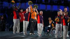 Volunteers receive flowers as recognition for their efforts during the Paralympics and Olympics Games during the Closing Ceremony on Day 11 of the L