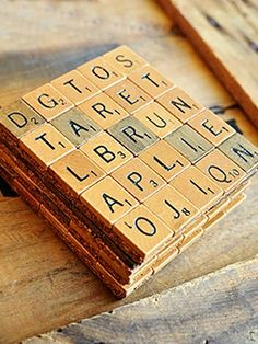 "Homemade Scrabble tile drink coasters  ""Word nerds will love these Scrabble tile coasters that can double as wedding favors. Buy tiles online (try eBay), spell out your guests' names and adhere to corkboard. It's that easy! Oh, and it's an inexpensive project too."""
