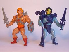 "Great shot of the original He-Man and Skeletor action figures, with accessories, from the ""Masters of the Universe"" line of toys"