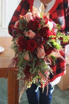 Gorgeous winter wedding cascade bouquet. Color scheme: Burgundy, red, champagne pink, dark purple, berries, evergreen, and gold. **Northern Virginia Floral designer Barbara Parsels**