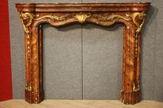 Italian scenic fireplace carved wood of the nineteenth century, gilded and lacquered faux marble. Visit our website www.parino.it